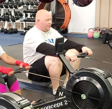 a veteran works out on a rowing machine