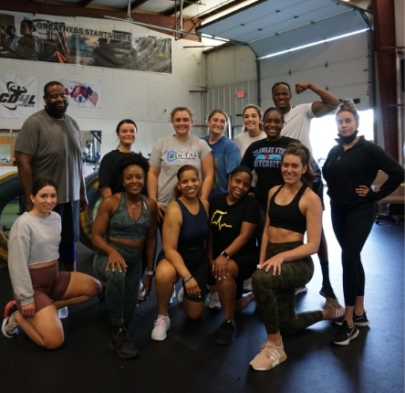 breaking barriers personal trainer vaughn poses with his clients