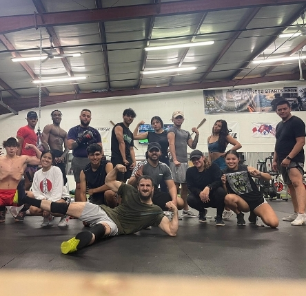 a diverse group of people show off their muscles after a workout