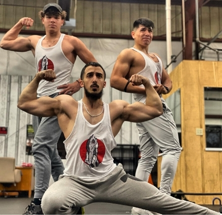 three men flexing their muscles