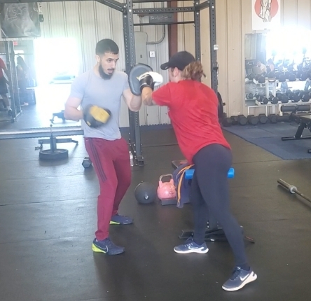 a woman works out with her personal trainer